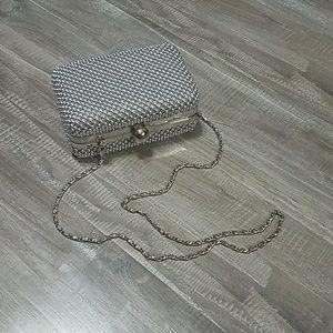 Cute silver beaded clutch